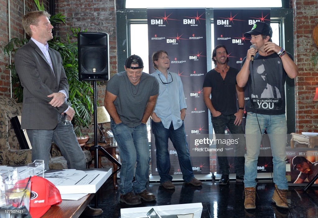 Chrysalis' Kos Weaver, Co-writer Dan Couch, Corn Man Music's Nate Lowery, Corn Man Music's Brett James, co-writer Dan Couch, Corn Man Music's Nate Lowery and Singer/Songwriter Kip Moore attend the BMI #1 Party For 'Hey Pretty Girl' By Kip Moore at Flying Saucer Draught Emporium on August 22, 2013 in Nashville, Tennessee.