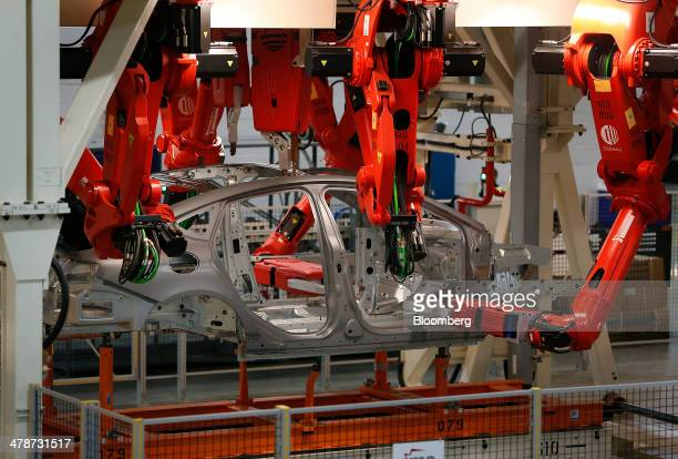 Chrysler 200 vehicle moves through the paint shop of the company's Sterling Heights Assembly Plant in Sterling Heights Michigan US on Friday March 14...