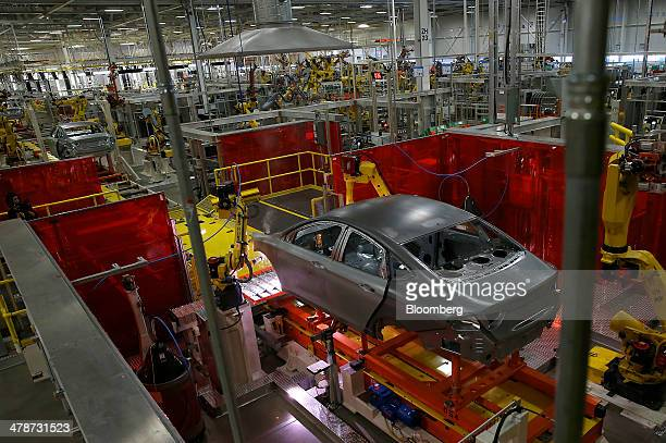 Chrysler 200 vehicles move along the production line in the body shop of the company's Sterling Heights Assembly Plant in Sterling Heights Michigan...