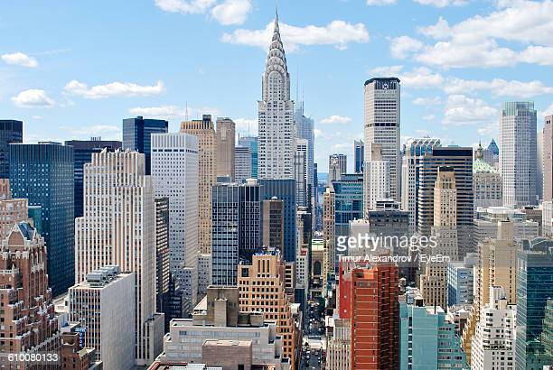 chrysler building amidst cityscape against sky - chrysler building stock pictures, royalty-free photos & images