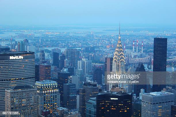 Chrysler Building Amidst Cityscape Against Sky