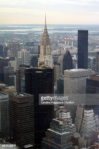 chrysler building amidst cityscape - carolina fragapane stock pictures, royalty-free photos & images