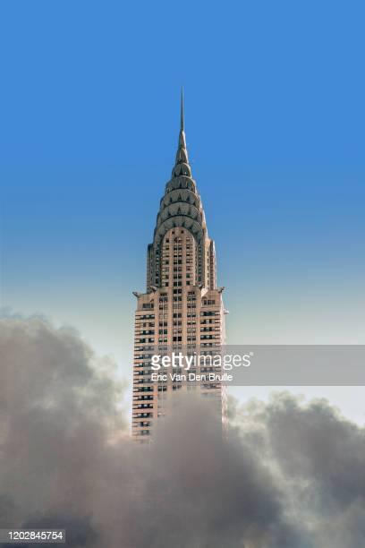 chrysler building emerging from clouds - eric van den brulle stock pictures, royalty-free photos & images