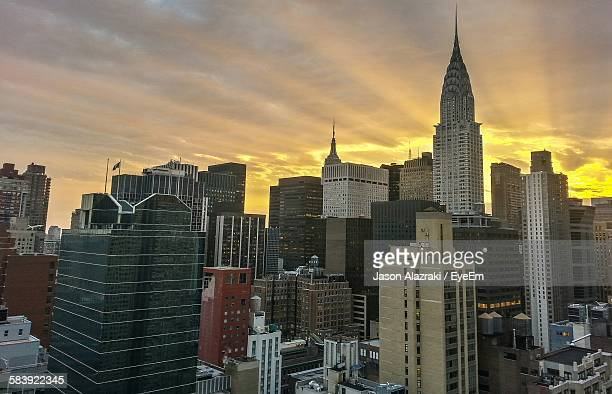 Chrysler Building In City Against Cloudy Sky During Sunset