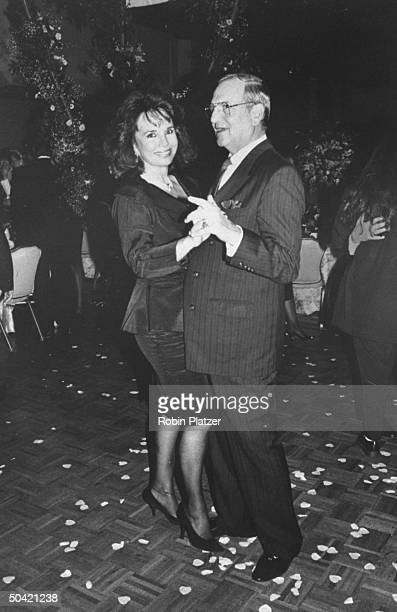 Chrysler chmn Lee Iacocca dancing w date Darrien Earle at the party after the premiere of the motion picture Steel Magnolias