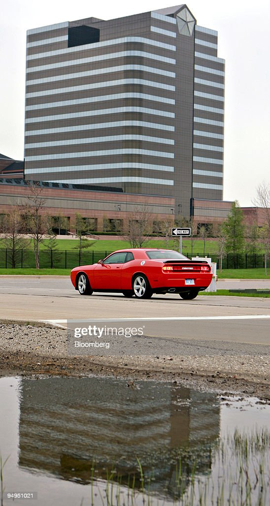 A Chrysler Dodge Challenger Passes By The Headquarters Of Chrysler
