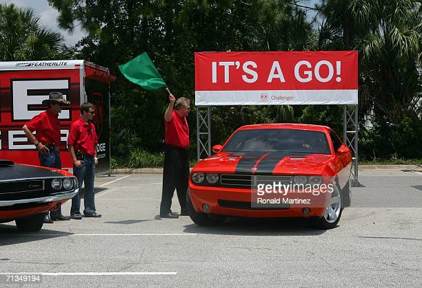 Chrysler Group announces the Dodge Challenger will return to production after nearly 35-year hiatus. Giving the green flag to signal the announcement...