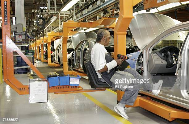 Chrysler Group assembly line worker Earl Gasaway sits in an ERGO seat while installing center consoles on a new 2007 Chrysler Sebring Sedan at the...
