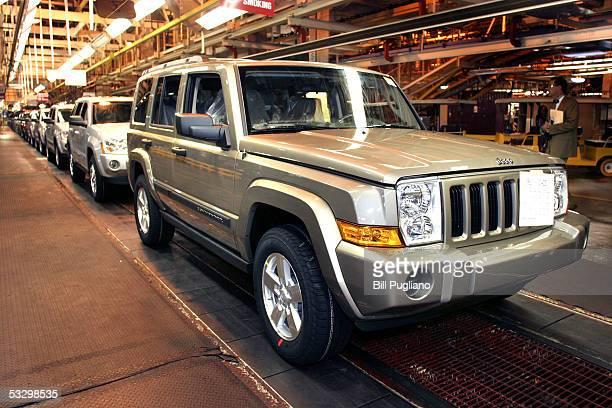 Chrysler Group assembly tech Dameon Hogan of Detroit MIchigan installs an instrument panel on a Jeep Grand Cherokee at the DaimlerChrysler Jefferson...