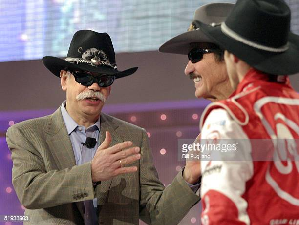 Chrysler Group Chairman and Chief Executive Officer Dieter Zetsche dons a cowboy hat and glasses he received from NASCAR racing legend Richard Petty...