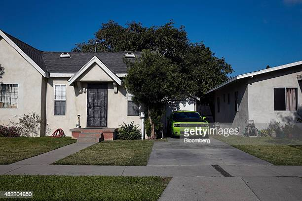 A Chrysler Group LLC Dodge Challenger vehicle sits in the driveway of a home in Compton California US on Monday July 6 2015 It can be a letdown for...