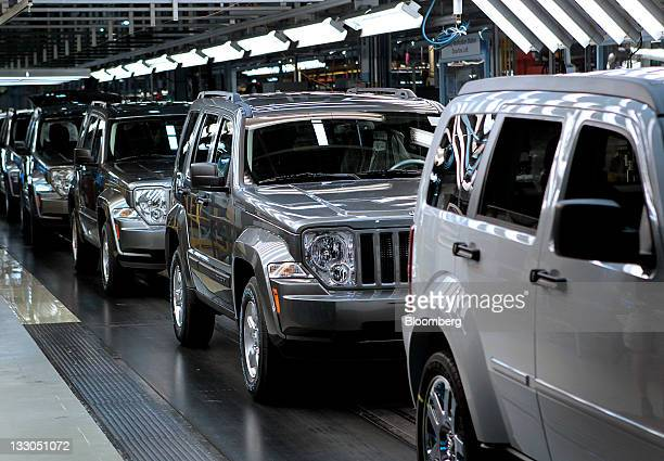 Chrysler Group LLC Jeep Liberty and Dodge Nitro vehicles move down the production line at the Toledo Assembly Complex in Toledo Ohio US on Wednesday...
