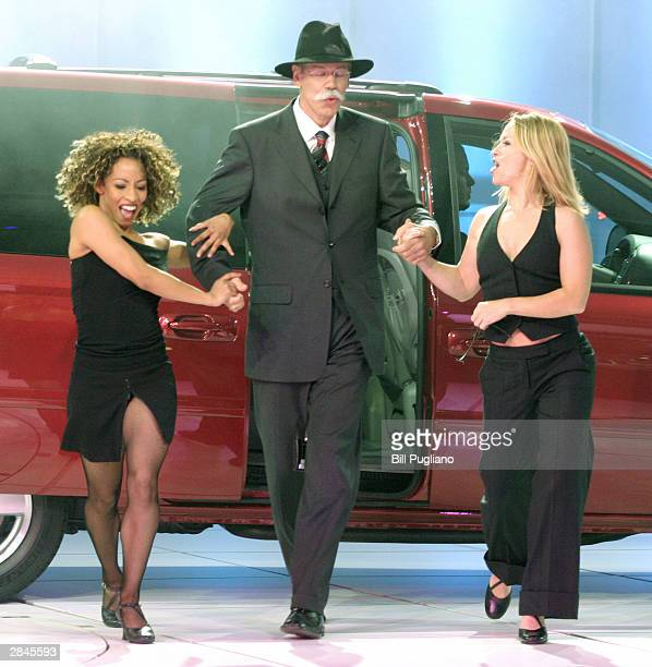Chrysler Group President and CEO Dieter Zetsche exits the new Dodge minivan during its introduction at the North American International Auto Show...
