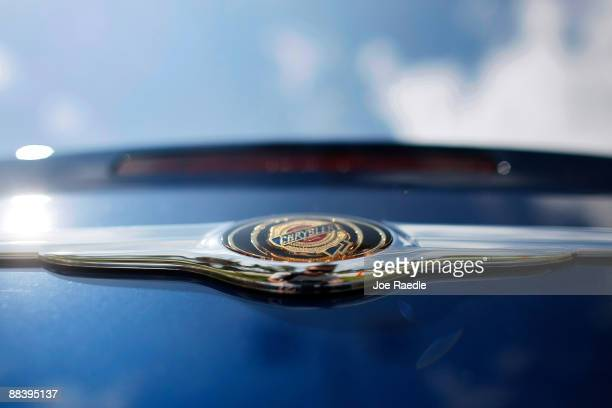 Chrysler vehicle icon is seen on the sales lot of Maroone Chrysler Jeep Dodge after it was forced to close on June 10 2009 in Coconut Creek Florida...
