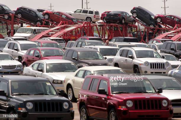 Chrysler vehicles are loaded onto a rail car for shipment at the Chrysler Assembly Plant on May 14, 2007 in Belvidere, Illinois. The Dodge Caliber...