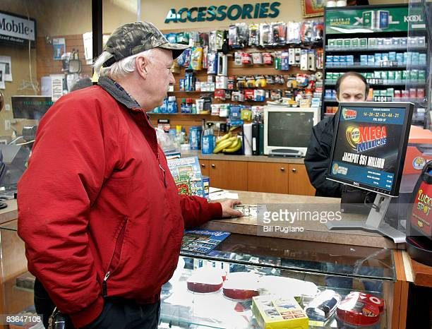 Chrysler worker buys a lottery ticket at a store near the Chrysler Warren Stamping Plant November 11, 2008 in Warren, Michigan. The auto industry is...