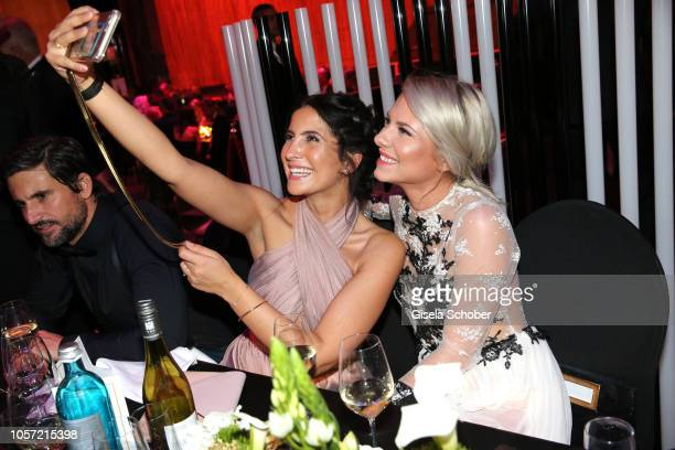 Chryssanthi Kavazi and Valentina Pahde take a selfie during the 25th Opera Gala aftershow party at Deutsche Oper Berlin on November 3 2018 in Berlin...
