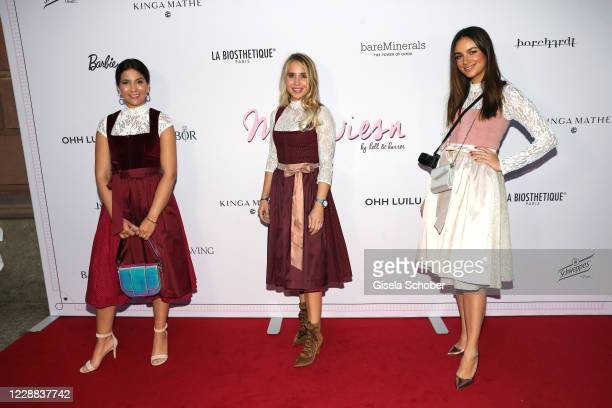 Chryssanthi Kavazi Nina Neuer and Janina Uhse attend the Madlwiesn 2020 at Restaurant Borchardt on October 1 2020 in Berlin Germany