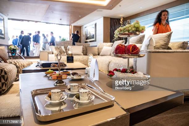 Chrystal macarons and fruit ornaments manufactured by Swarovski AG sit on display on a coffee table on board luxury superyacht Metis manufactured by...