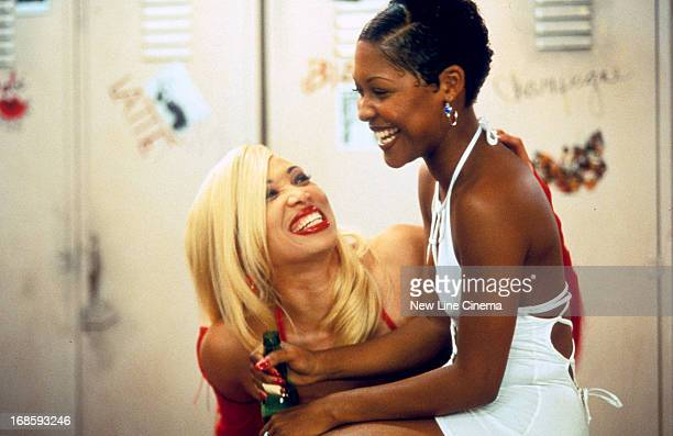Chrystale Wilson laughs with LisaRaye in a scene from the film 'The Players Club' 1998