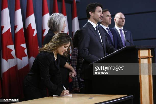 Chrystia Freeland Canada's deputy prime minister left takes notes while Patty Hajdu Canada's health minister from left Justin Trudeau Canada's prime...