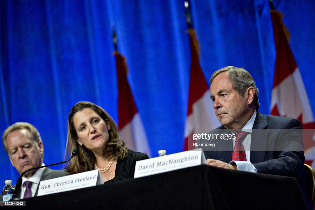 Chrystia Freeland, Canada's minister of foreign affairs, center, speaks as David MacNaughton, Canada's ambassador to the U.S., right, listens during the first round of North American Free Trade Agreement (NAFTA) renegotiations in Washington, D.C., U.S., on Wednesday, Aug. 16, 2017. Canada and Mexico largely want to defend the advantages they have enjoyed under the two-decade-old Nafta deal, keep it free of tariffs and broaden it to new industries. President Donald Trump has called Nafta the worst trade pact in history and promised to fix it through negotiations or withdraw. Photographer: Andrew Harrer/Bloomberg via Getty Images