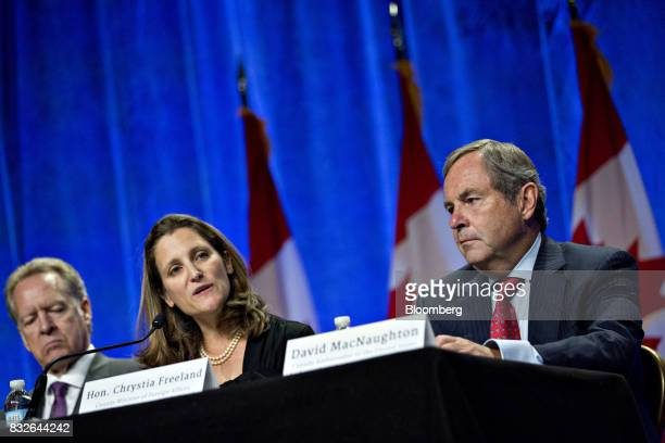 Chrystia Freeland Canada's minister of foreign affairs center speaks as David MacNaughton Canada's ambassador to the US right listens during the...