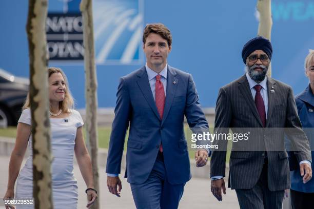 Chrystia Freeland Canada's minister of foreign affairs left Justin Trudeau Canada's prime minister center and Harjit Sajjan Canadas defence minister...