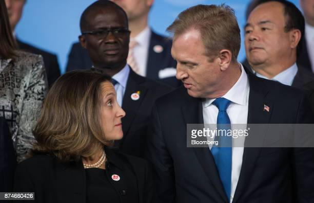 Chrystia Freeland Canada's minister of foreign affairs left speaks with Patrick Shanahan US deputy secretary of defense before a family photo during...