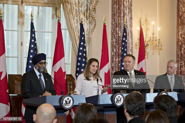 Chrystia Freeland Canada's minister of foreign affairs second left speaks as Harjit Sajjan Canada's defense minister from left Mike Pompeo US...