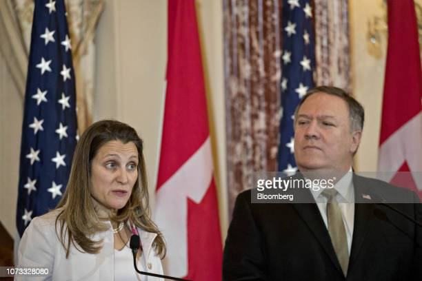 Chrystia Freeland Canada's minister of foreign affairs speaks as Mike Pompeo US secretary of state right listens at a news conference during a...