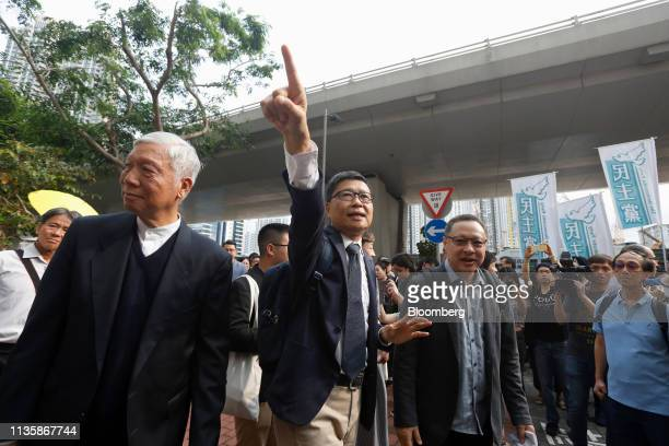 Chu Yiuming Baptist minister and cofounder of activist group Occupy Central with Love and Peace from left Chan Kinman retired associate professor of...