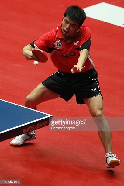 Chuang Chih-Yuan of Chinese Taipei plays a backhand during his match against Leung Chu Yan of Hongkong during the LIEBHERR table tennis team world...