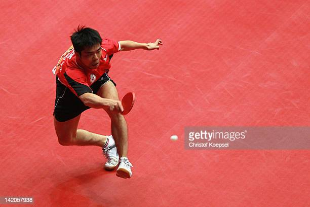 Chuang Chih-Yuan of Chinese Taipei plays a forehand during his match against Leung Chu Yan of Hongkong during the LIEBHERR table tennis team world...