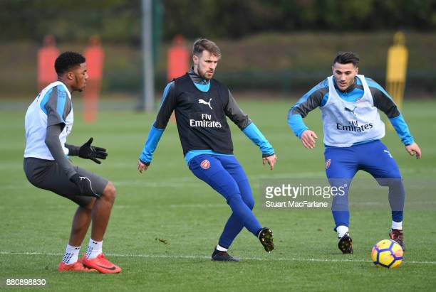 Chuba Akpom Aaron Ramsey and Sead Kolasinac of Arsenal during a training session at London Colney on November 28 2017 in St Albans England