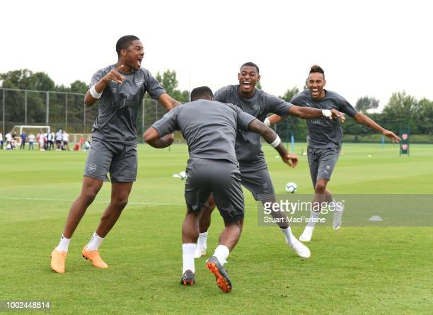 Chuba Akpom Alex Lacazette Jeff ReineAdelaide and PierreEmerick Aubameyang of Arsenal during a training session at London Colney on July 20 2018 in...