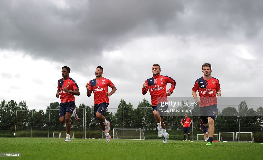 Chuba Akpom, Alex Oxlade-Chamberlain, Jack Wilshere and Dan Crowley of Arsenal during a training session at London Colney on July 8, 2015 in St Albans, England.