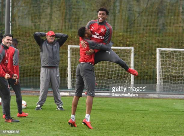 Chuba Akpom and Alex Iwobi of Arsenal during a training session at London Colney on November 21 2017 in St Albans England