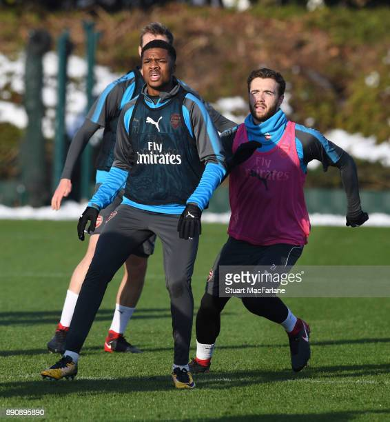 Chuba Akpom and Calum Chambers of Arsenal during a training session at London Colney on December 12 2017 in St Albans England
