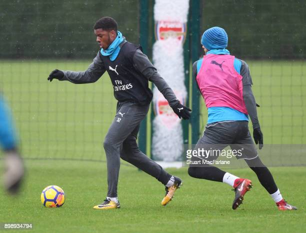 Chuba Akpom and Calum Chambers of Arsenal during a training session at London Colney on December 27 2017 in St Albans England