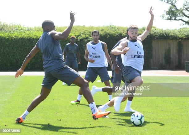 Chuba Akpom and Calum Chambers of Arsenal during a training session at London Colney on July 3 2018 in St Albans England