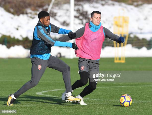 Chuba Akpom and Granit Xhaka of Arsenal during a training session at London Colney on December 12 2017 in St Albans England