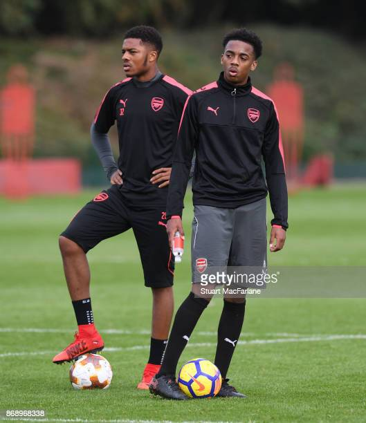 Chuba Akpom and Joe Willock of Arsenal during a training session at London Colney on November 1 2017 in St Albans England
