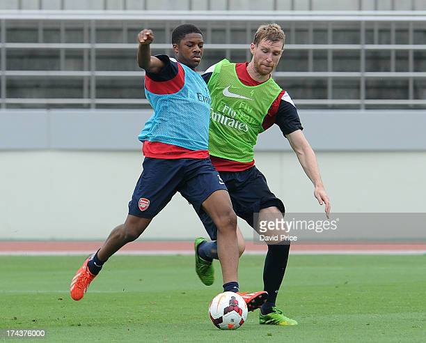 Chuba Akpom and Per Mertesacker of Arsenal FC in Japan for the club's pre-season Asian tour at the Urawa Komaba Stadium on July 25, 2013 in Saitama,...
