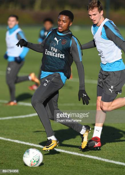 Chuba Akpom and Rob Holding of Arsenal during a training session at London Colney on December 18 2017 in St Albans England