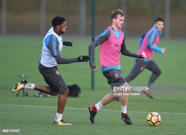 Chuba Akpom and Rob Holding of Arsenal during a training session at London Colney on December 30 2017 in St Albans England