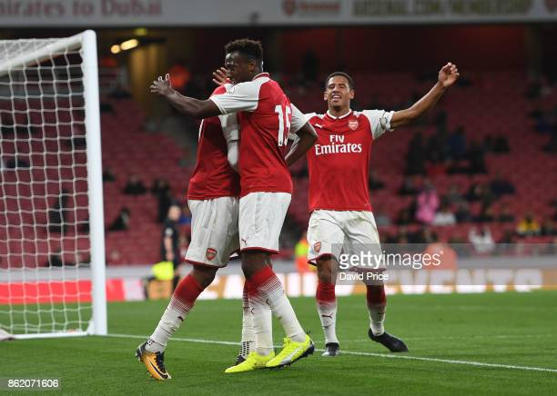 Chuba Akpom celebrates scoring Arsenal's 2nd goal with Tolaji Bola and Marcus McGuane during the Premier League 2 match between Arsenal and...