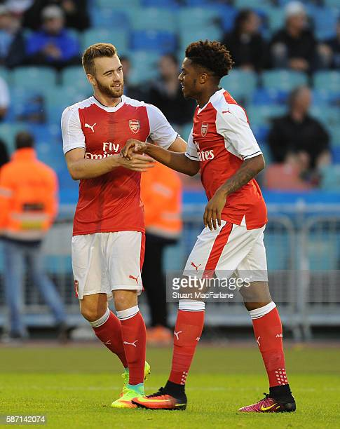Chuba Akpom celebrates scoring the 3rd Arsenal goal with Calum Chambers during the pre season friendly between Arsenal and Manchester City at the...
