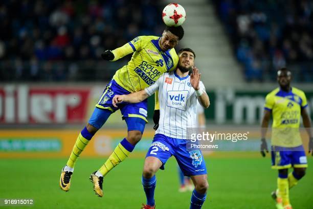 Chuba Akpom forward of STVV beats Samuel Gigot defender of KAA Gent to the ball during the Jupiler Pro League match between KAA Gent and Sint...