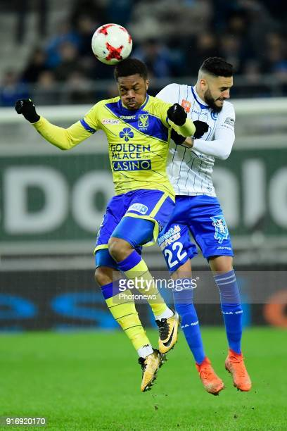 Chuba Akpom forward of STVV in action with Dylan Bronn defender of KAA Gent during the Jupiler Pro League match between KAA Gent and Sint Truidense...